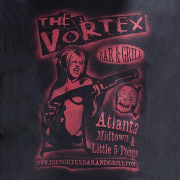 VORTEX_GirlWithGun_detail_grande